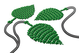 foto of fuel economy  - Green transport concept as a group of cars and automobiles in a leaf shape connected with roads as a metaphor for alternative fuel as electric power biofuel or fuel cell hydrogen as a symbol for the future of environmentally friendly transportation - JPG