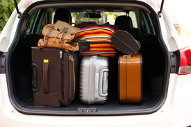 stock photo of heavy bag  - Suitcases and bags in trunk of car ready to depart for holidays - JPG