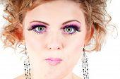 Blonde with fancy make-up grimacing