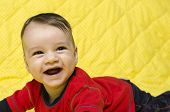 Happy baby boy laughing