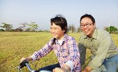 Happy Father Teaching Child To Ride Bicycle