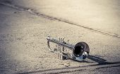 Vintage Of Trumpet Placed On Concrete