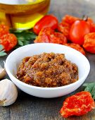 Italian red pesto of sun-dried tomatoes with garlic and herbs