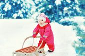 Baby Sledding In The Winter Day