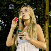 Blonde Blowing Soap Bubble
