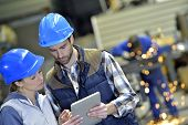 stock photo of engineering construction  - Engineers in steel factory working on digital tablet - JPG