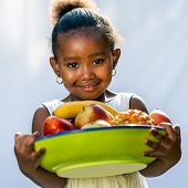 Sweet Afro American Girl With Fruit Bowl.