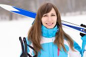 Young Caucasian Woman With Ski At Snowy Winter Day.