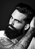 B/w Portrait Of A Tattooed Bearded Man