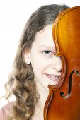 Young Girl With Braces Behind Violin