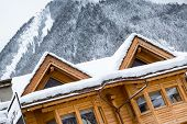 picture of chalet  - Snow covered chalet in the mountains - JPG