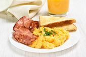stock photo of scrambled eggs  - Breakfast with scrambled eggs and bacon on white plate - JPG