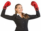 foto of bent over  - Businesswoman wearing boxing gloves standing in victory pose - JPG
