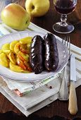 French Cuisine: Black Pudding With Apples And Wineglass