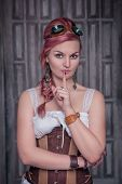 Beautiful Steampunk Woman In Corset Making Silence Gesture