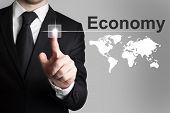 Businessman Pushing Button Economy Worldmap