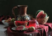 Water-melon And Apples And Water-melon Juice In A Transparent Mug