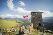Georgia flag mountain village towers tourism