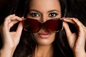 stock photo of beautiful face  - Beautiful sexy fashion latina woman wearing sunglasses - JPG