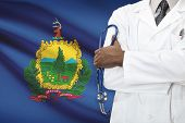 Concept Of National Healthcare System - Vermont flag on background
