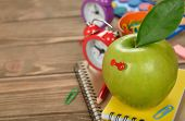 Green apple with red pushpin