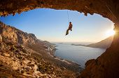 Rock climber hanging on rope while lead climbing