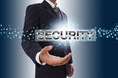 Businessman hand showing security button