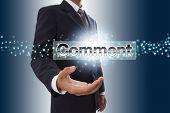 Businessman hand showing comment button