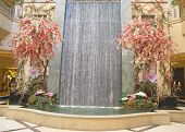 Waterfall and spring decorations in the atrium of The Palazzo Resort Hotel Casino in Las Vegas