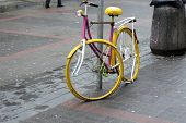 vintage pink and yellow bike on the street