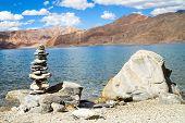 Pangong Tso Mountain Lake Panorama With Buddhist Stupas In Forefront