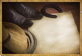 stock photo of headgear  - cowboy background with western hat and lasso and paper for text - JPG