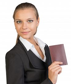 stock photo of passport cover  - Businesswoman showing passport with blank cover - JPG