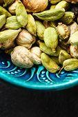 stock photo of cardamom  - Various Cardamom Spices in Authentic Turkish Crockery - JPG
