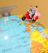 picture of vespa  - Toy miniature figures of a couple traveling on a Vespa - JPG