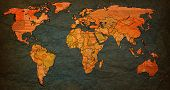 foto of flags world  - austria flag on old vintage world map with national borders - JPG
