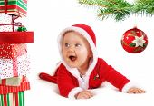 Christmas Baby Unders A Tree With Gifts