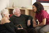 stock photo of visitation  - Nurse visiting senior couple at home - JPG