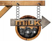 image of milk  - Wooden sign with directional arrow with text Milk and steel cans for the transport of milk - JPG