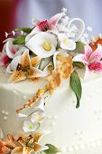 Beautiful Flowers On Top Of A Wedding Cake