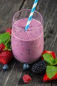 image of fruit shake  - Homemade antioxidant summer fruits smoothie on rustic table - JPG