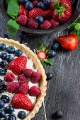 foto of tarts  - Homemade tart with fresh berries summer fruit on rustic table - JPG