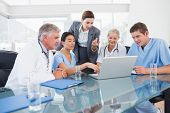 pic of medical office  - Team of doctors and businesswoman having a meeting in medical office - JPG