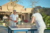 picture of ping pong  - Elderly couple playing ping pong outside