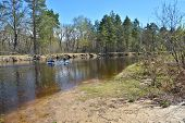 stock photo of kayak  - Kayak tourists on spring river. The journey on the river PRA in the national Park near Ryazan Russia ** Note: Soft Focus at 100%, best at smaller sizes - JPG