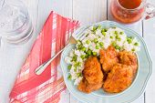picture of thighs  - Chicken thighs marinated and baked in Russian dressing sauce served with rice and peas - JPG