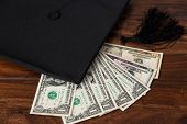 foto of academia  - a Mortar Board and dollars concept tuition - JPG
