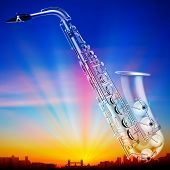 pic of saxophones  - abstract sunrise background with silhouette of london and saxophone - JPG