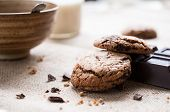 stock photo of biscuits  - Breakfast table with chocolate biscuits and a cup of milk - JPG
