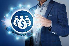 stock photo of money  - Businessman make money and save money on virtual screens - JPG